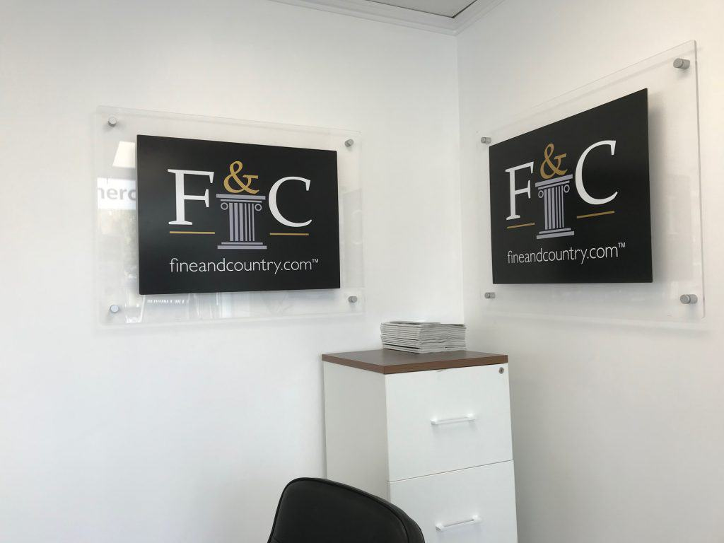 These acrylic wall signs are displayed in an office.