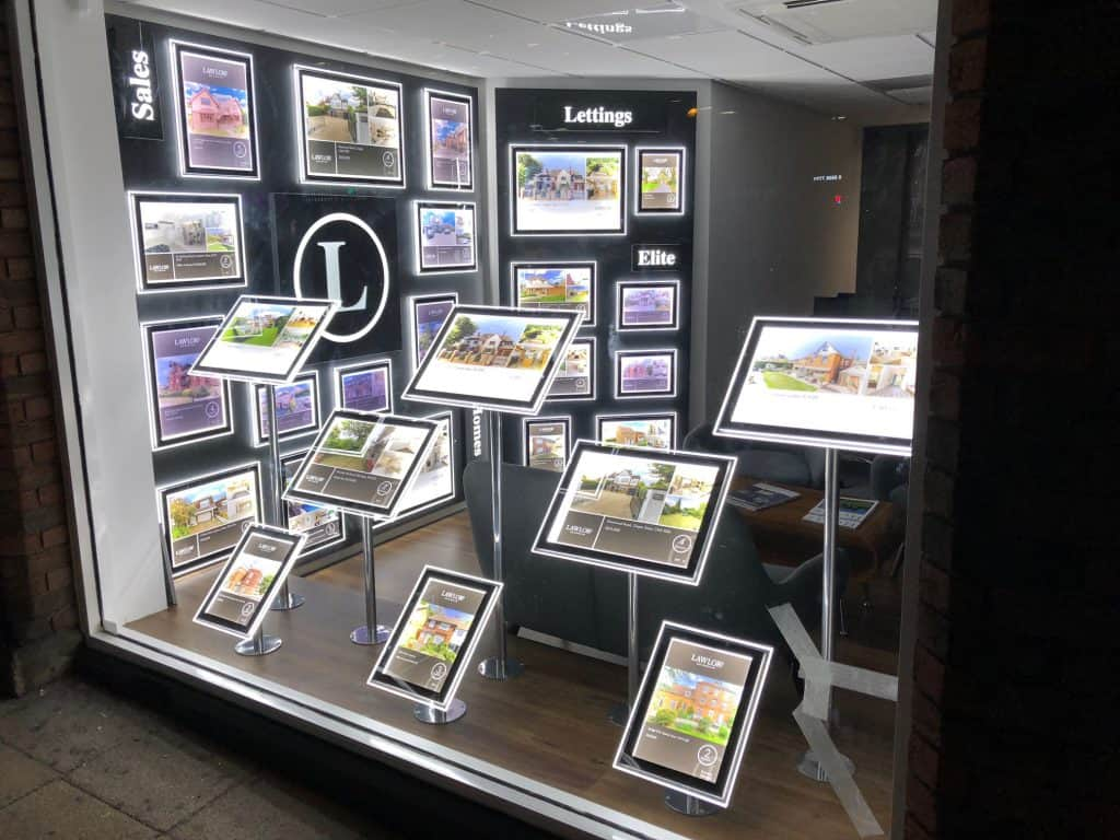 This bespoke window display was created using brand colours to illuminate properties at night.