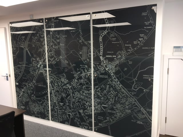 This Bespoke glass map displays the local area around an estate agents office.