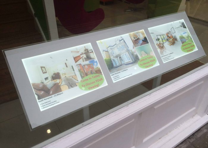 freestanding window display in a shop window for an estate agent