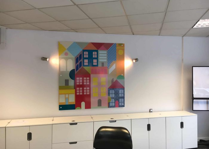 A wall graphic of artwork on the inside of an office.