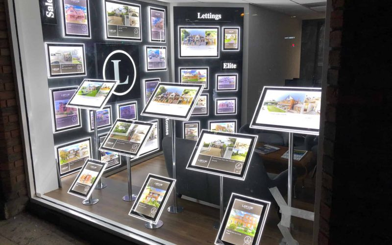 This bespoke led window display was created both with freestanding display wallets and a bespoke wall for lettings and sales.