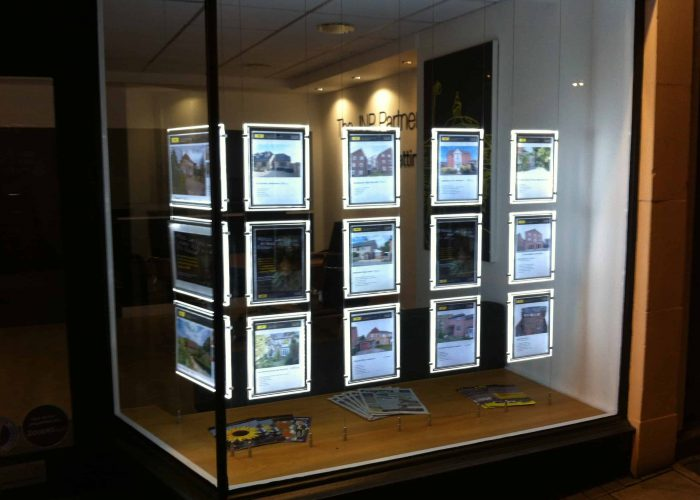 Illuminated led window wallets displaying properties in a office.